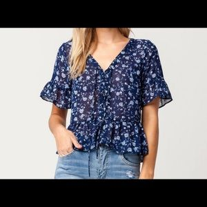 beautiful floral blue top never worn